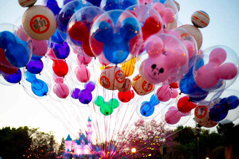 Colored Mickey Balloons with Sleeping Beauty Castle Disneyland