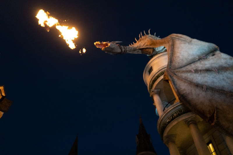 Dragon breathing fire in the Wizarding World of Harry Potter Orlando at night