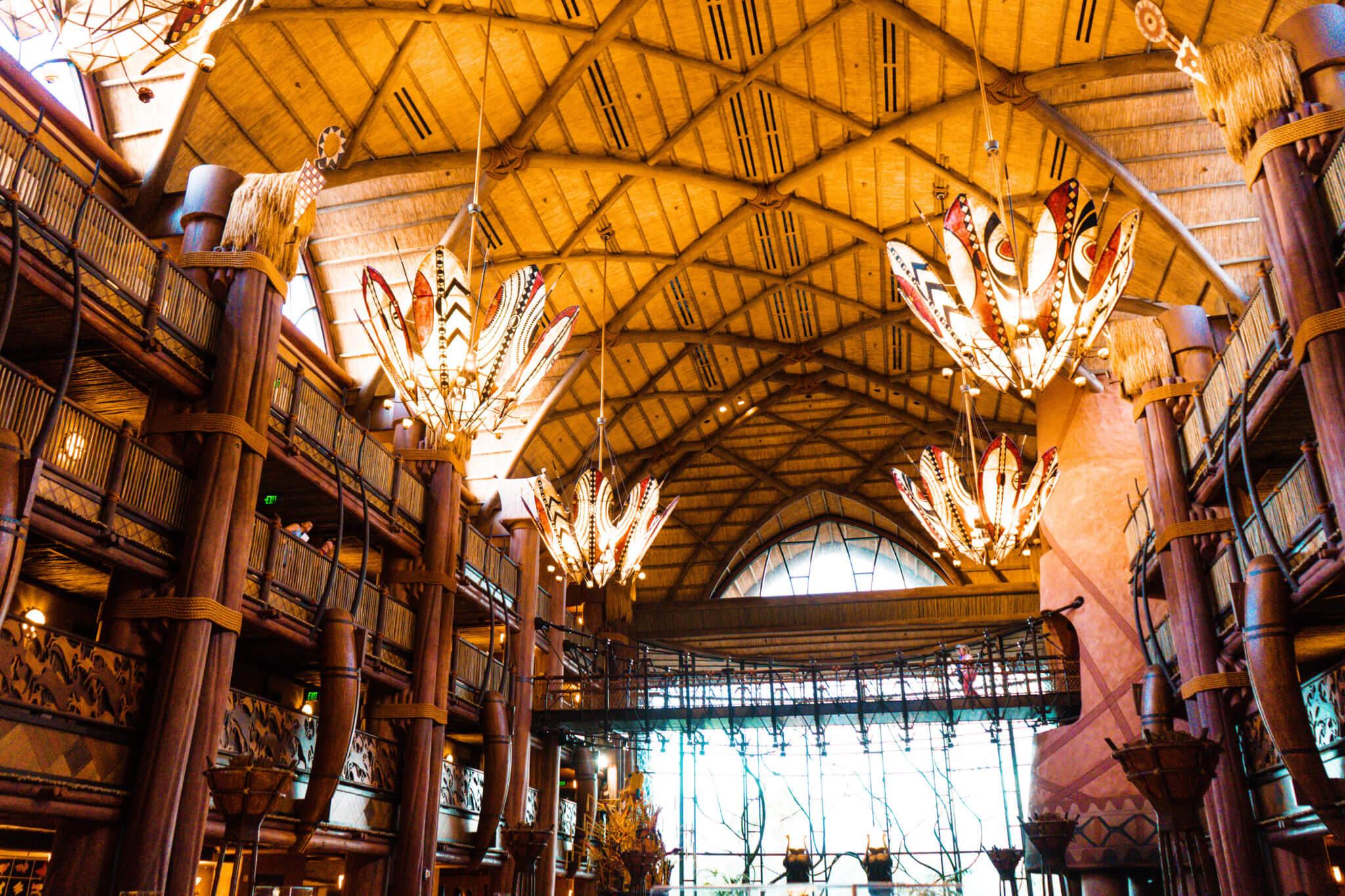 Warmly lit Animal Kingdom Lodge lobby and chandeliers at Disney World