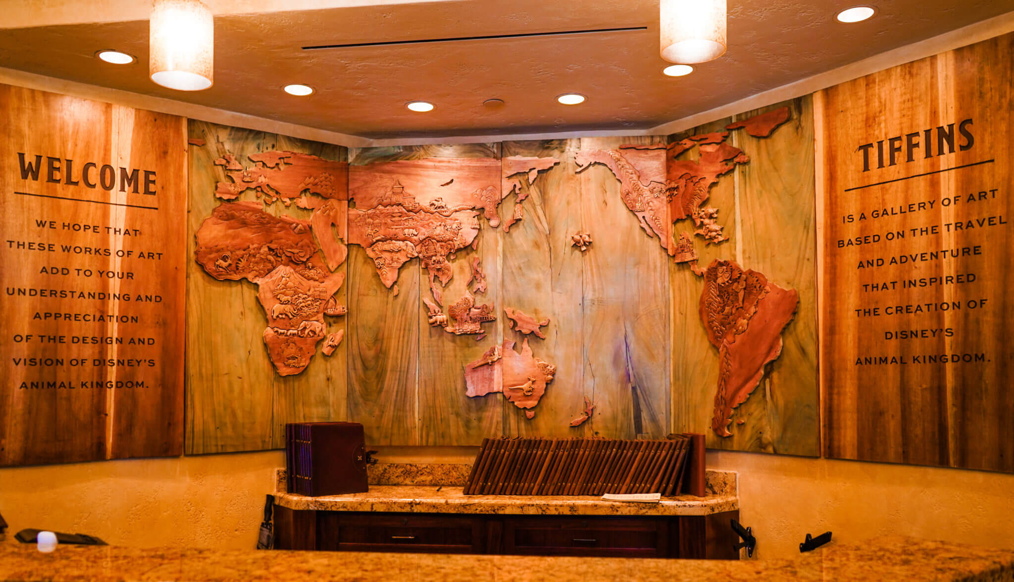 Tiffins Front Desk with wooden map of the world - Animal Kingdom at Disney World
