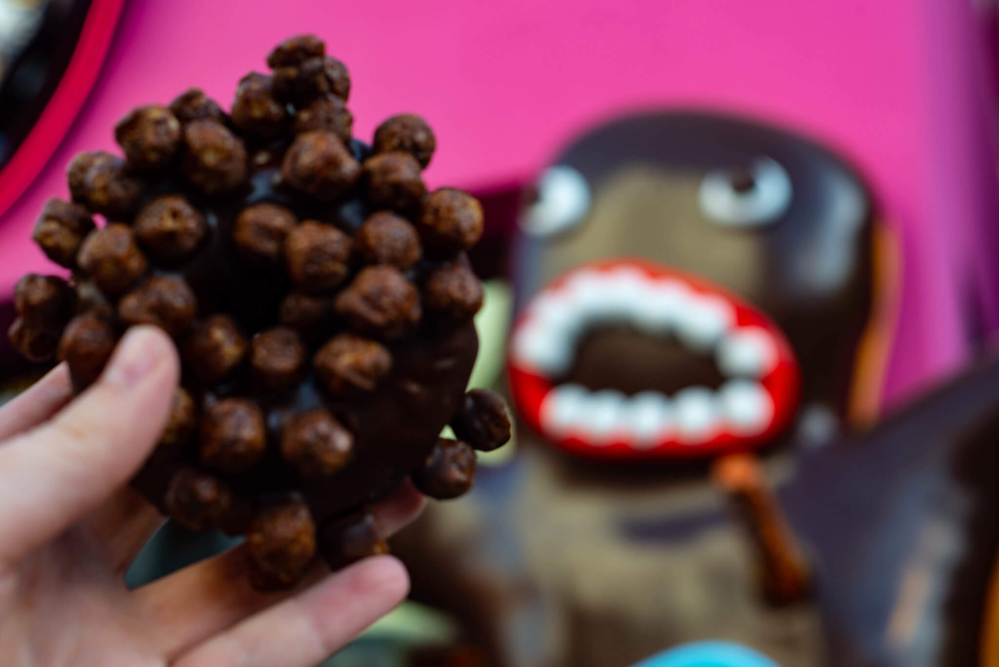 Triple chocolate doughnut in front of Universal Studios Hollywood CityWalk