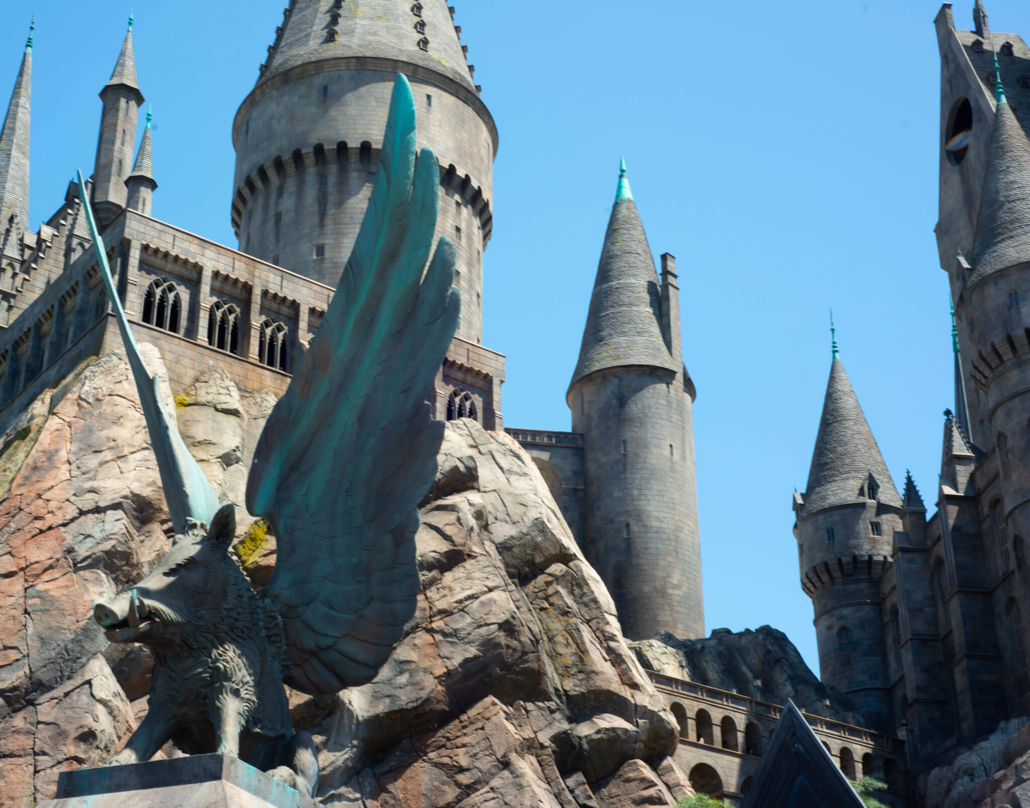 Hog with with wings statue in front of Hogwarts Castle at Universal Studios Hollywood