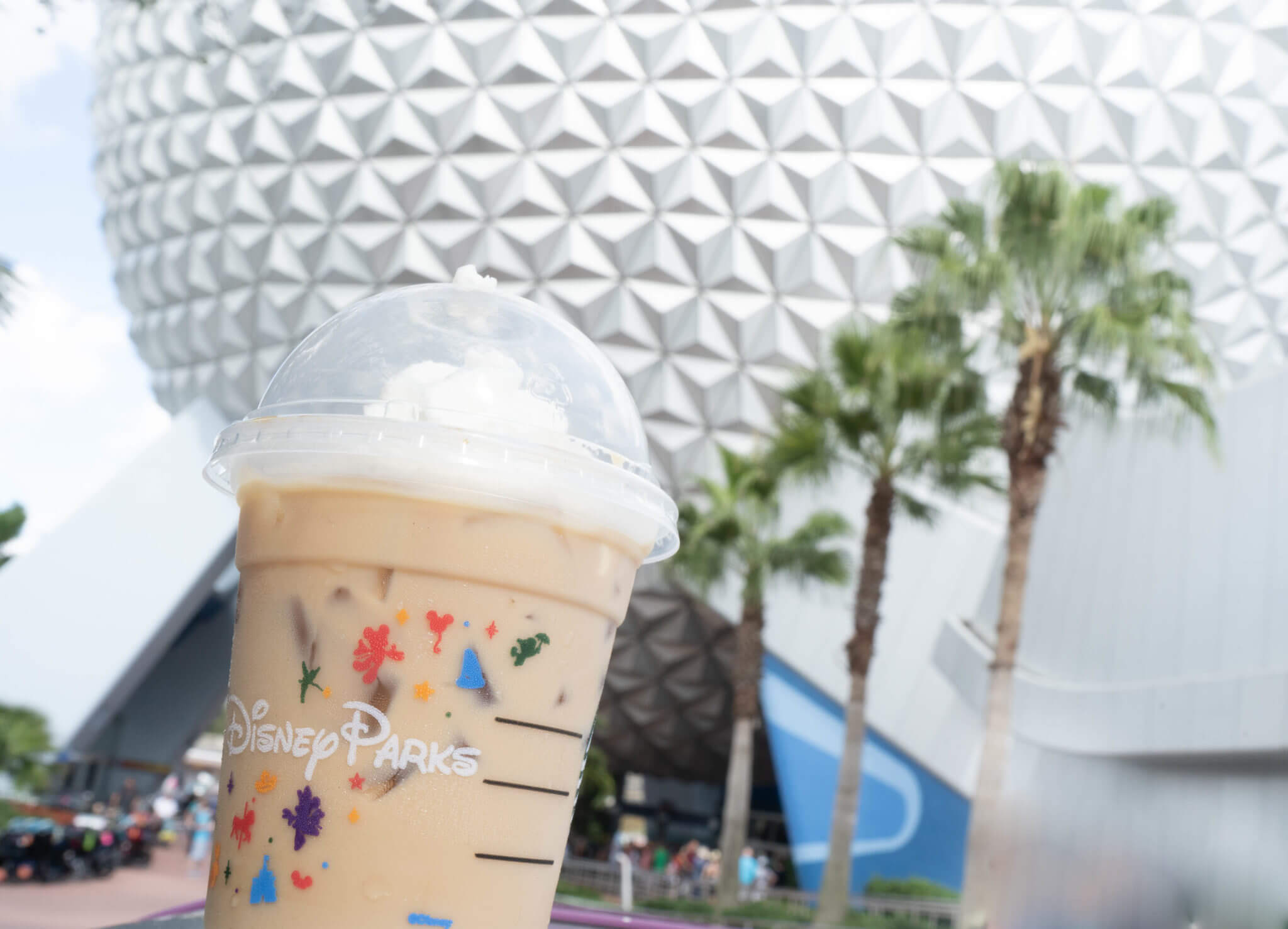 Epcot's Spaceship Earth and Starbucks Iced Coffee in Disney World