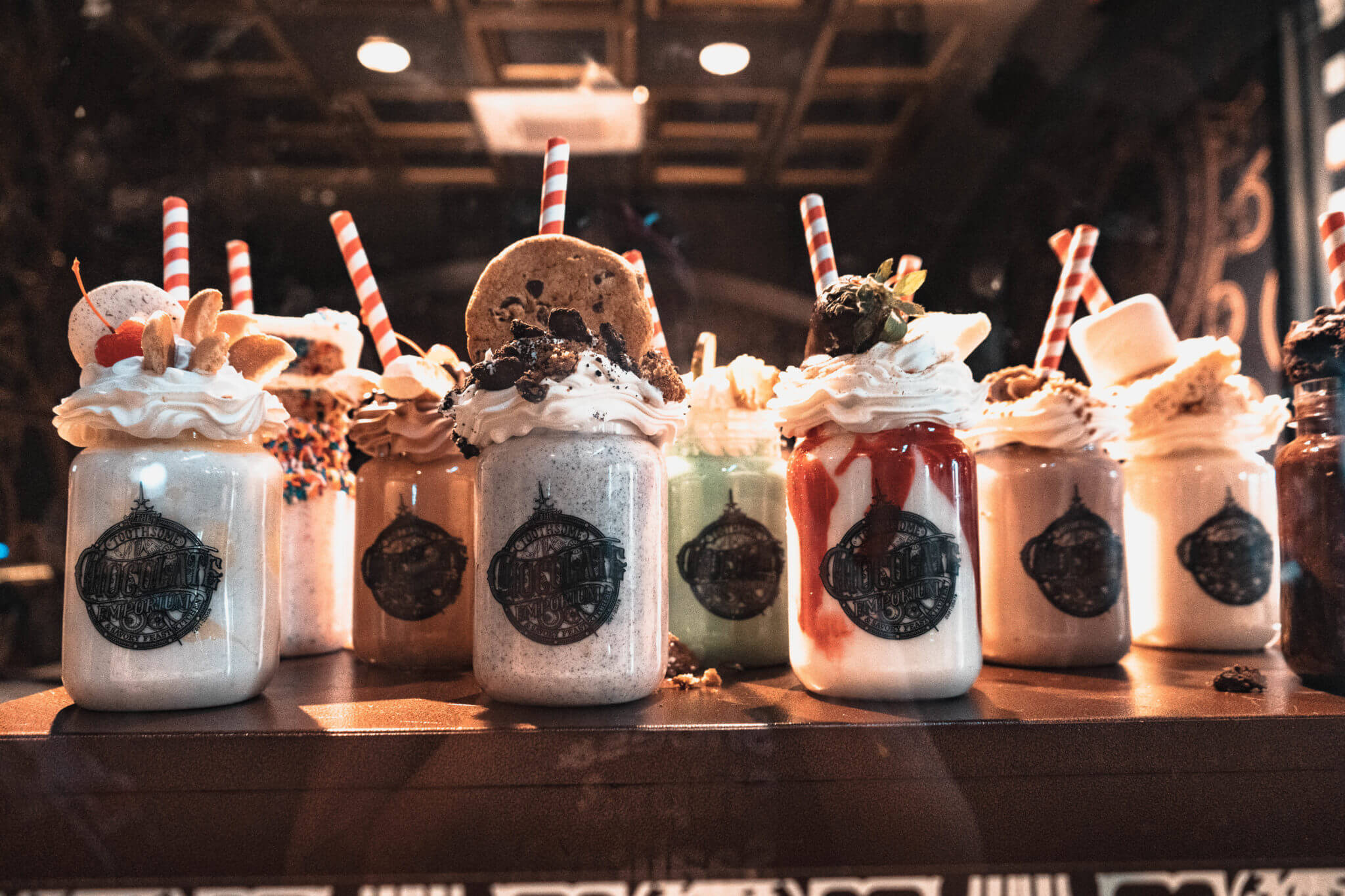Display of chocolate, red velvet, and marshmallow milkshakes from Toothsome Chocolate Emporium and Savory Feast Kitchen in Universal Studios CityWalk
