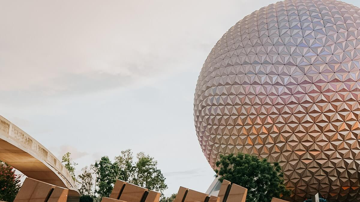 Epcot's Spaceship Earth in a pink filter and monorail track