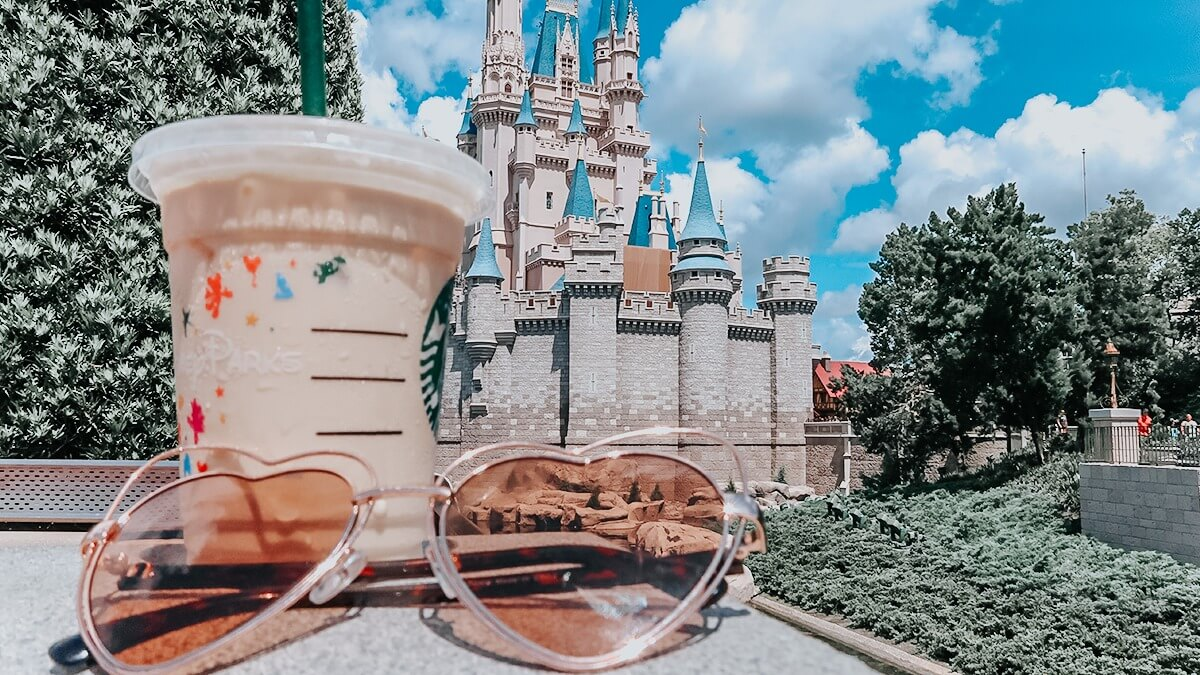 Iced latte in front of Cinderella Castle in Disney World